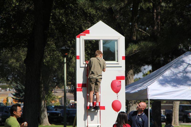 Kid climbs down ladder